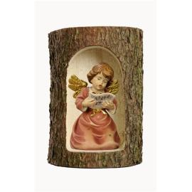 Bell angel with notes in a tree trunk