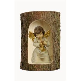 Bell angel with trumpet  in a tree trunk