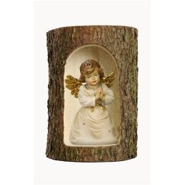 Bell angel praying in a tree trunk