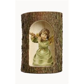 Bell angel with flute in a tree trunk