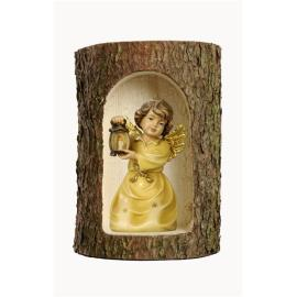 Bell angel with lantern in a tree trunk