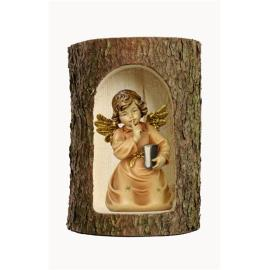 Bell angel with book in a tree trunk