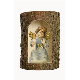 Bell angel with candle in a tree trunk