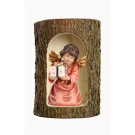 Bell angel with parcel in a tree trunk