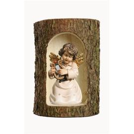 Bell angel with lyre in a tree trunk