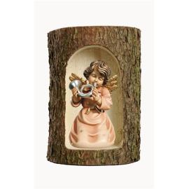 Bell angel with horn in a tree trunk