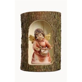 Bell angel with drum in a tree trunk