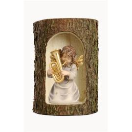 Bell angel with tuba in a tree trunk