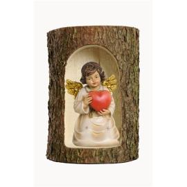 Bell angel with heart in a tree trunk