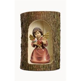 Bell angel with bird in a tree trunk