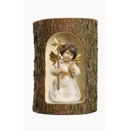 Bell angel with star in a tree trunk